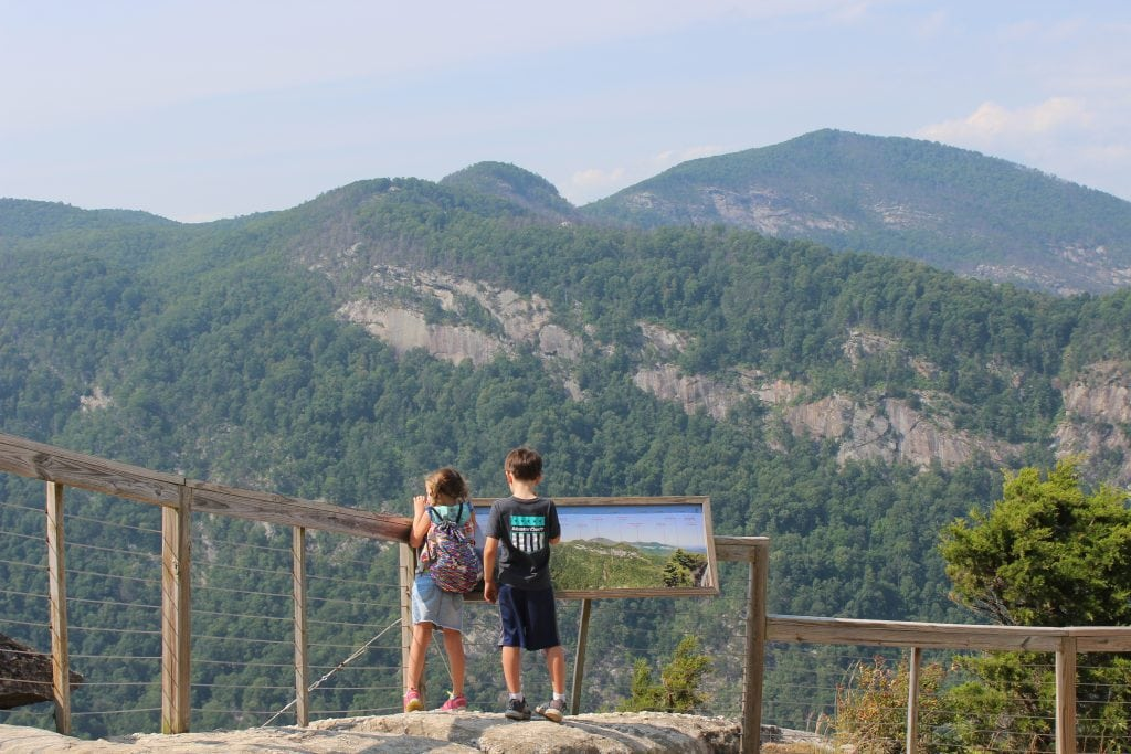 Picture of children looking out at mountains on family vacation