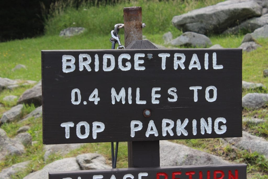 picture of a sign showing bridge trail and the distance