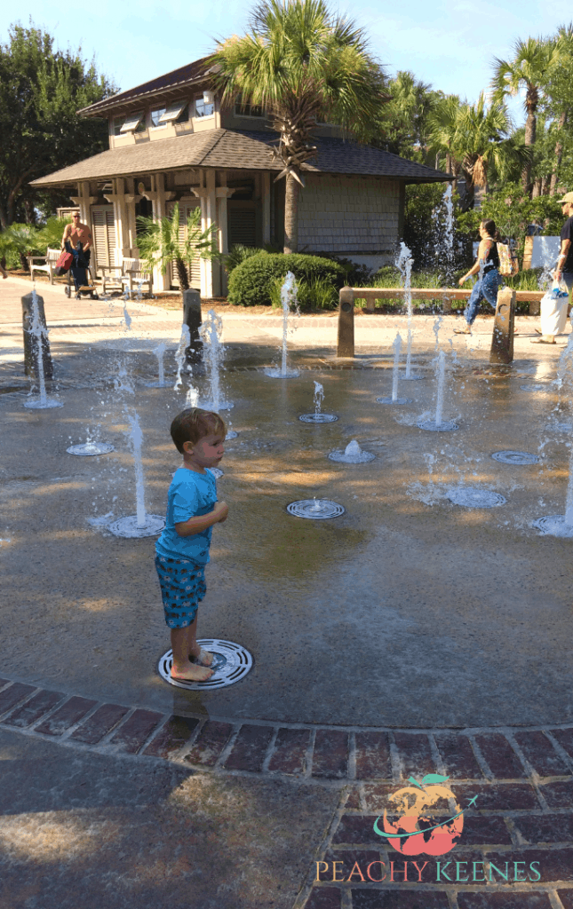 Little Boy Playing in a Fountain at Caligny Beach