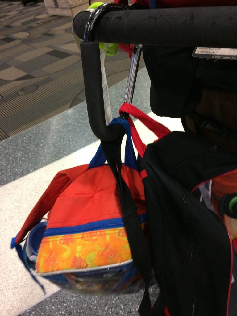 picture of stroller clip & go holding backpacks on a stroller