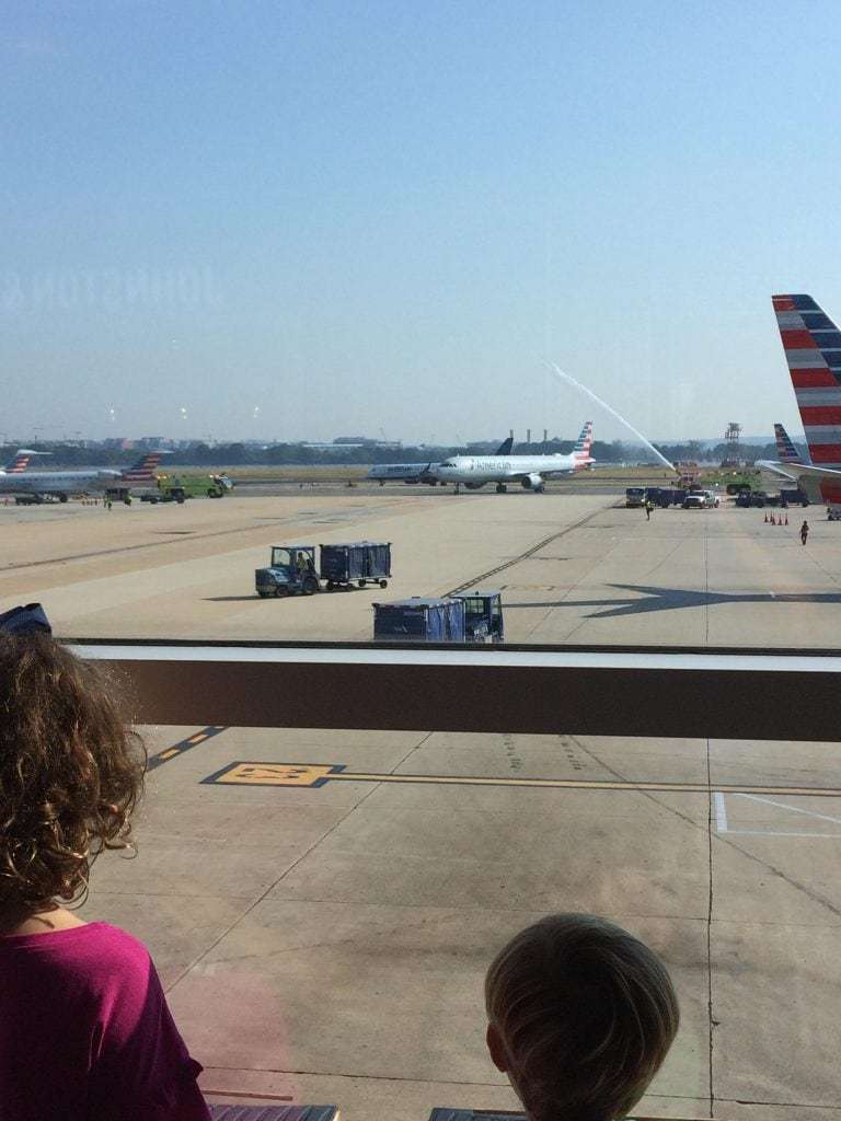 Children looking out a window at a plane in washington d.c.