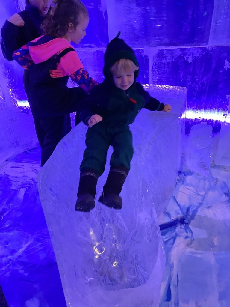 child on ice slide