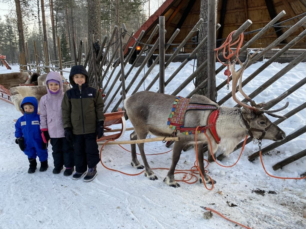 picture with children with reindeer in Santa Claus Village Finland
