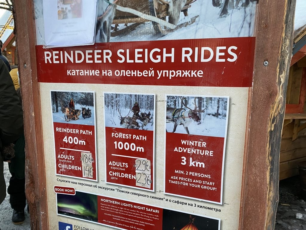 Sign describing the different options for reindeer sleigh rides in Rovaniemi Finland