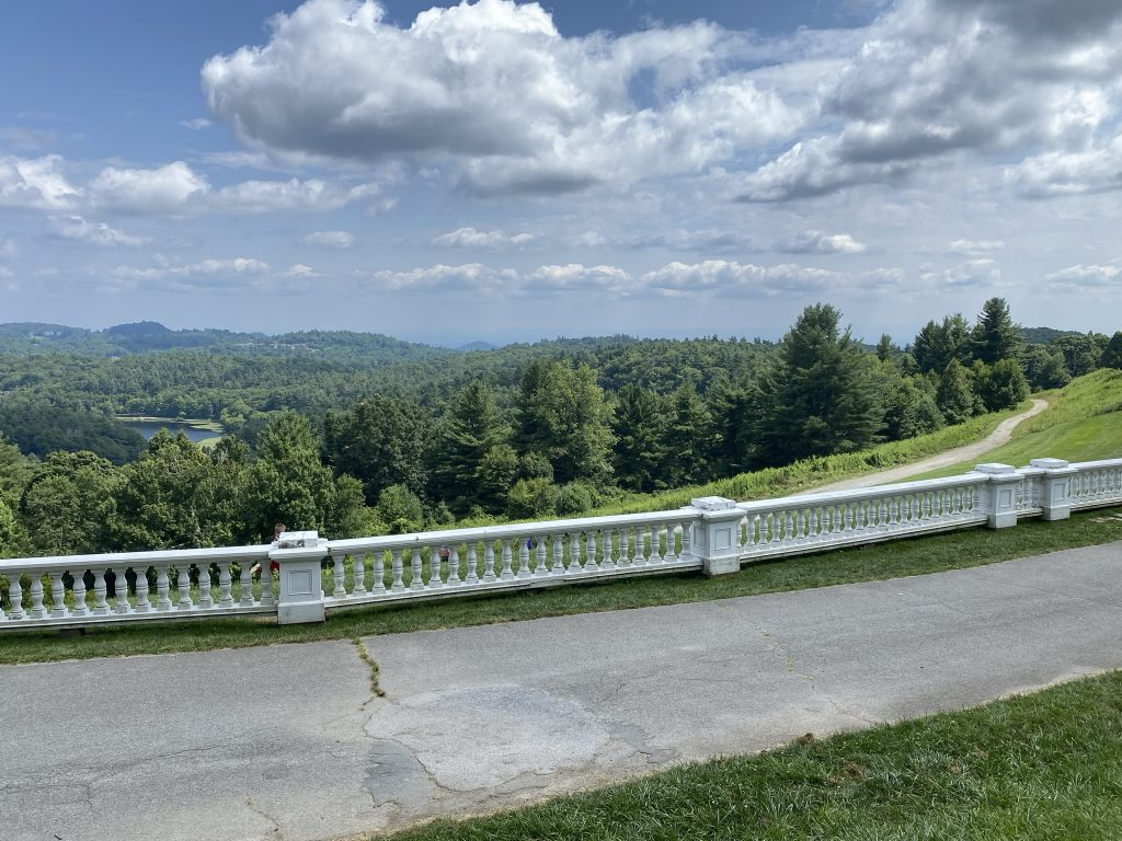 View of trees and mountains and a carriage trail at Moses Cone Manor.